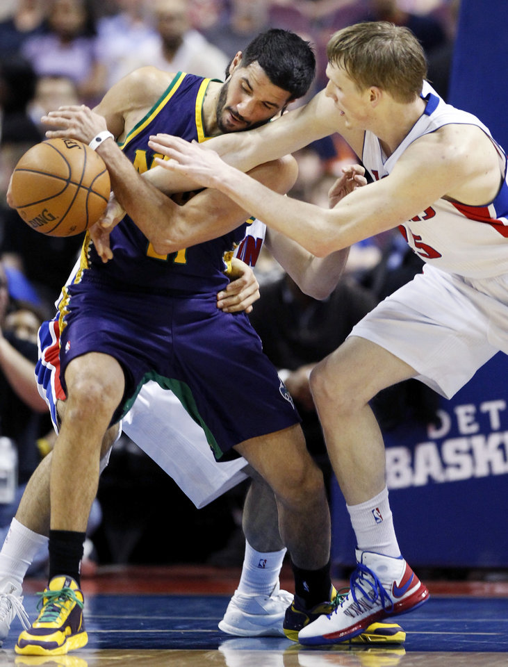 Detroit Pistons forward Kyle Singler, right, tries to steal the ball from New Orleans Hornets guard Greivis Vasquez in the first half of an NBA basketball game, Monday, Feb. 11, 2013, in Auburn Hills, Mich. (AP Photo/Duane Burleson)