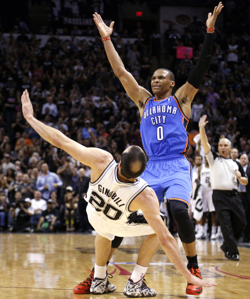 Photo - Oklahoma City's Russell Westbrook (0) argues after being called for a foul as San Antonio's Manu Ginobili (20) falls to the ground during Game 2 of the Western Conference Finals in the NBA playoffs between the Oklahoma City Thunder and the San Antonio Spurs at the AT&T Center in San Antonio, Wednesday, May 21, 2014. Photo by Sarah Phipps