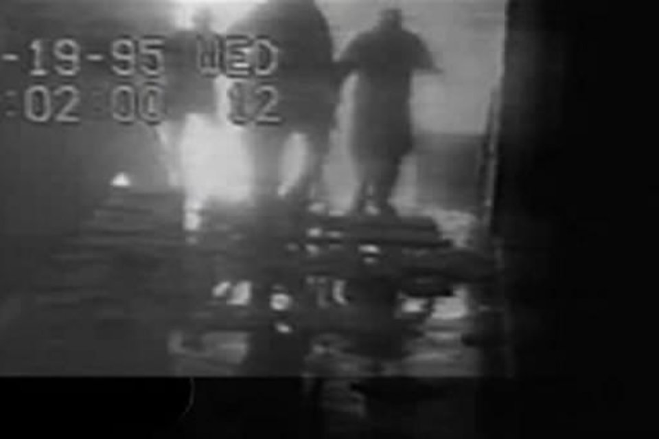 Photo - This frame grab taken from security video released by the FBI and provided to The Oklahoman shows people moving through a nearby building shortly after the  bombing of the Alfred P. Murrah Federal Building in  Oklahoma  City on April 19, 1995. The tapes were obtained by an attorney and provided to The ( Oklahoma  City) Oklahoman, the newspaper reported Sunday, Sept. 27, 2009. (AP Photo/FBI via the Oklahoman)