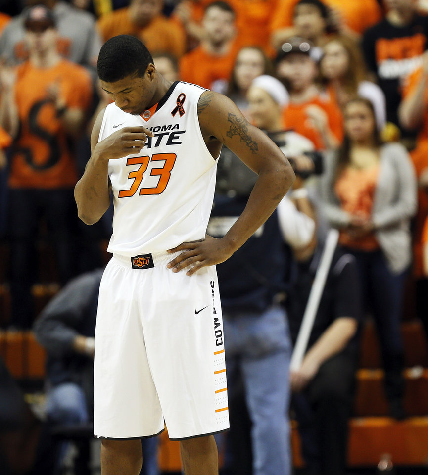 Photo - Oklahoma State's Marcus Smart (33) crosses himself during a pre-game ritual before a men's college basketball game between Oklahoma State University (OSU) and the University of Texas at Gallagher-Iba Arena in Stillwater, Okla., Saturday, March 2, 2013. Photo by Nate Billings, The Oklahoman