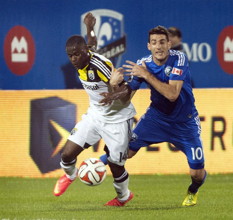 Photo - Montreal Impact's Ignacio Piatti, right, and Columbus Crew's Waylon Francis battle for the ball during first half of an MLS soccer game in Montreal, Saturday, Aug. 30, 2014. (AP Photo/The Canadian Press, Graham Hughes)
