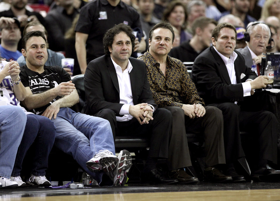 Photo - FILE - In this Dec. 26, 2009, file photo, from left, brothers Phil, George, Gavin and Joe Maloof, co-owners of the Sacramento Kings, watch an NBA basketball game in Sacramento, Calif. After backing out of the deal to build a new arena in Sacramento and announcing the sale of the Kings to a group that wants to move the team to Seattle, the brothers have become the city's most-reviled villains heading into a preliminary NBA meeting on the issue Wednesday, April 3, 2013, in New York. (AP Photo/Rich Pedroncelli, File)