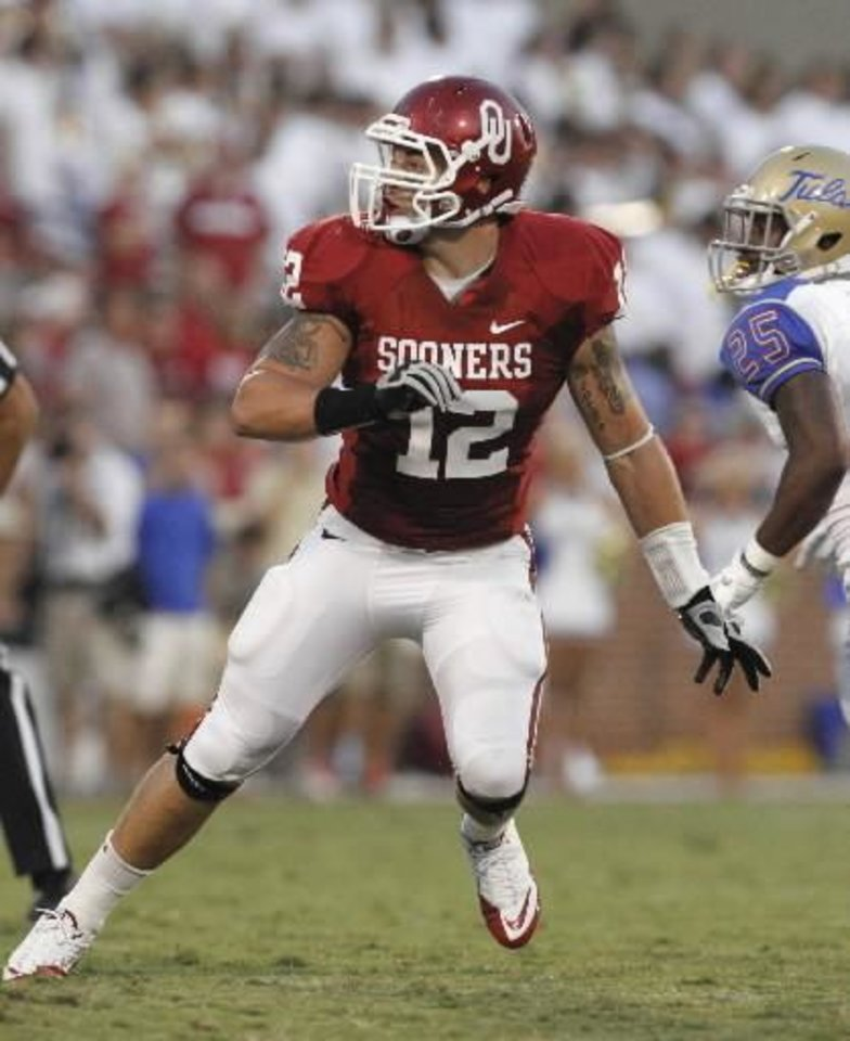 Photo - Oklahoma's Tom Wort (12) plays wearing the jersey number of Austin Box during the first half of the college football game between the University of Oklahoma Sooners ( OU) and the Tulsa University Hurricanes (TU) at the Gaylord Family-Memorial Stadium on Saturday, Sept. 3, 2011, in Norman, Okla. Photo by Steve Sisney, The Oklahoman ORG XMIT: KOD