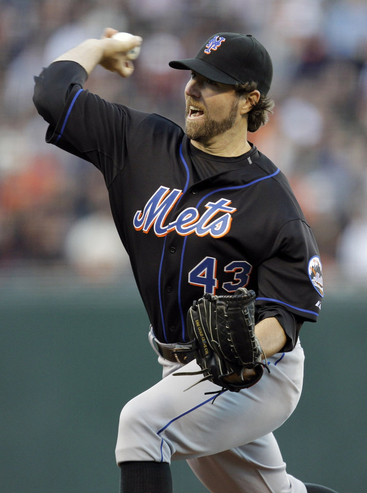 New York Mets starter R.A. Dickey throws to the San Francisco Giants during the first inning of a baseball game in San Francisco,  Thursday, July 15, 2010. (AP Photo/Marcio Jose Sanchez) ORG XMIT: FXPB103