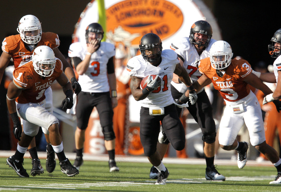 Photo - Oklahoma State's Jeremy Smith (31)gets through the Texas defense during second half of a college football game between the Oklahoma State University Cowboys (OSU) and the University of Texas Longhorns (UT) at Darrell K Royal-Texas Memorial Stadium in Austin, Texas, Saturday, Oct. 15, 2011. Photo by Sarah Phipps, The Oklahoman