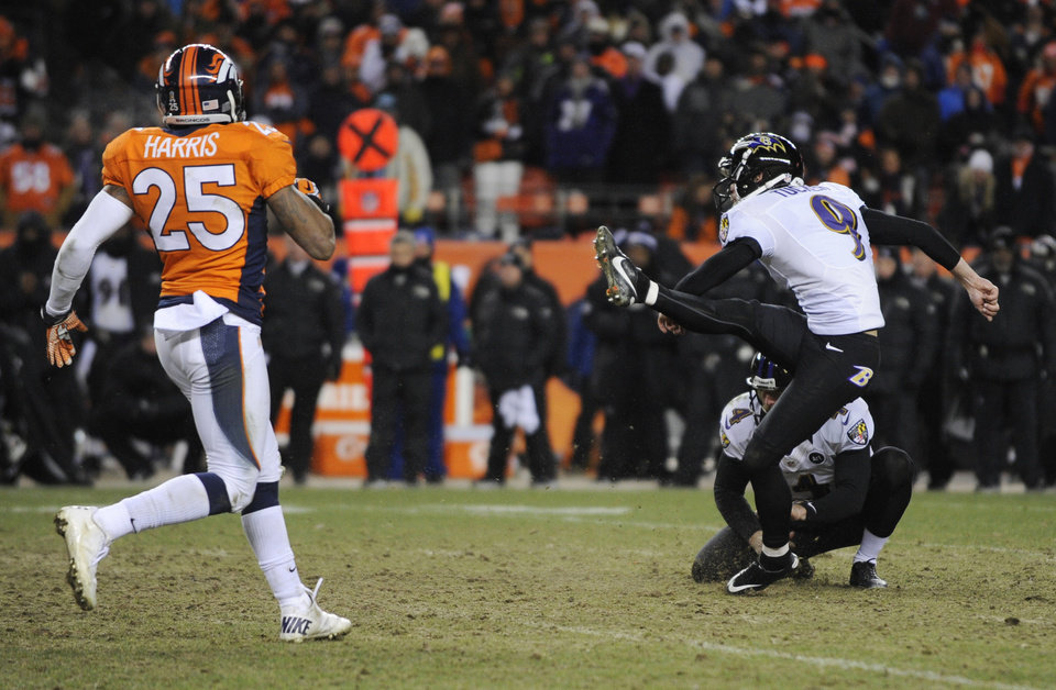Baltimore Ravens kicker Justin Tucker (9) kicks the game winning field goal as Baltimore Ravens punter Sam Koch (4) holds against the Denver Broncos in overtime of an AFC divisional playoff NFL football game, Saturday, Jan. 12, 2013, in Denver. The Ravens won 38-35. Left is Denver Broncos cornerback Chris Harris. (AP Photo/Jack Dempsey)