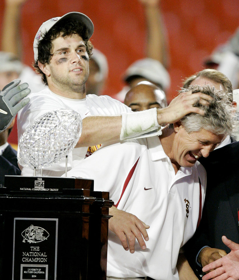 Miami, Florida - January 4, 2005. University of Oklahoma (OU) Sooners vs. University of Southern California (USC) Trojans college football in the Orange Bowl BCS National Championship at Pro Player Stadium. USC quarterback  Matt Leinart, left, celebrates USC's 55-19 Orange Bowl win over Oklahoma with head coach Pete Carroll to capture the BSC National Championship.  By Bryan Terry/The Oklahoman