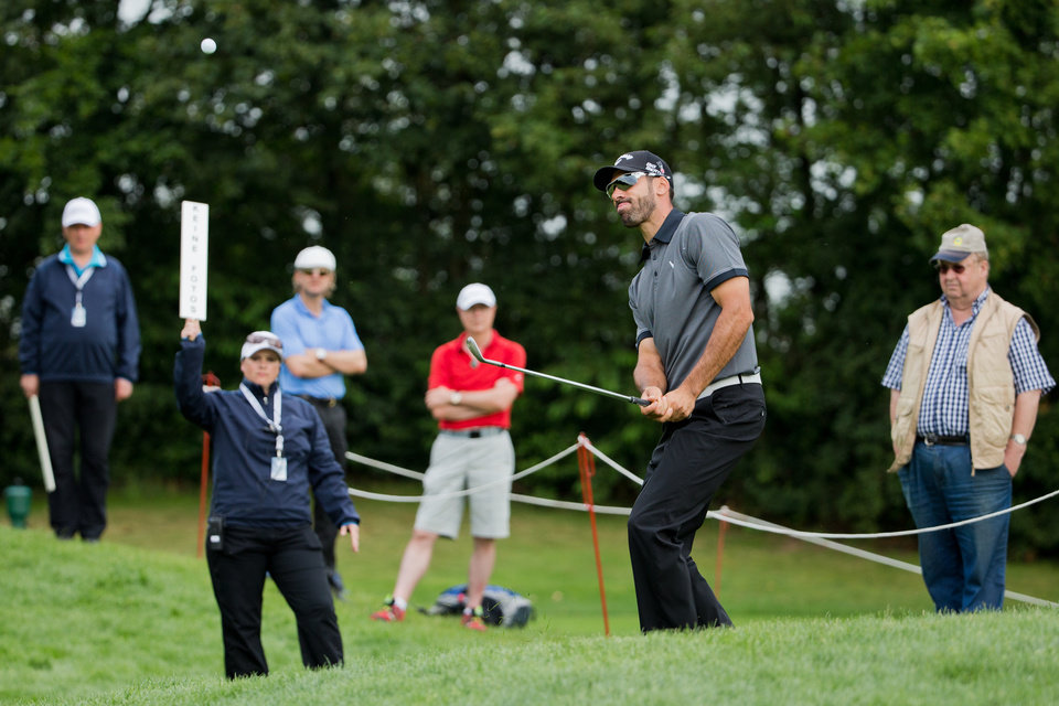 Photo - Spain's  Alvaro Quiros watches his shot during the  BMW International Open golf tournament  in Pulheim near Cologne, Germany,  Friday June 27, 2014.  (AP Photo/dpa,Rolf Vennenbernd)