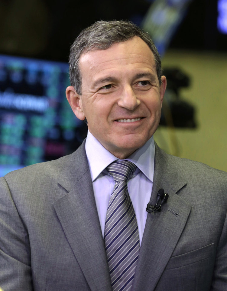 Photo - FILE - In this Tuesday, March 12, 2013, file photo, Bob Iger, chairman and CEO of The Walt Disney Company, is interviewed on the floor of the New York Stock Exchange. Iger was the seventh highest paid CEO in 2013 at $34.3 million, as calculated by The Associated Press and Equilar, an executive pay research firm. (AP Photo/Richard Drew, File)