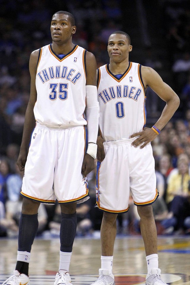 Photo - OKLAHOMA CITY THUNDER / MEMPHIS GRIZZLIES / NBA BASKETBALL  Oklahoma City Thunder players Kevin Durant (35) and Russell Westbrook during the Thunder - Grizzlies game April 14, 2010 in the Ford Center in Oklahoma City.    BY HUGH SCOTT, THE OKLAHOMAN ORG XMIT: KOD