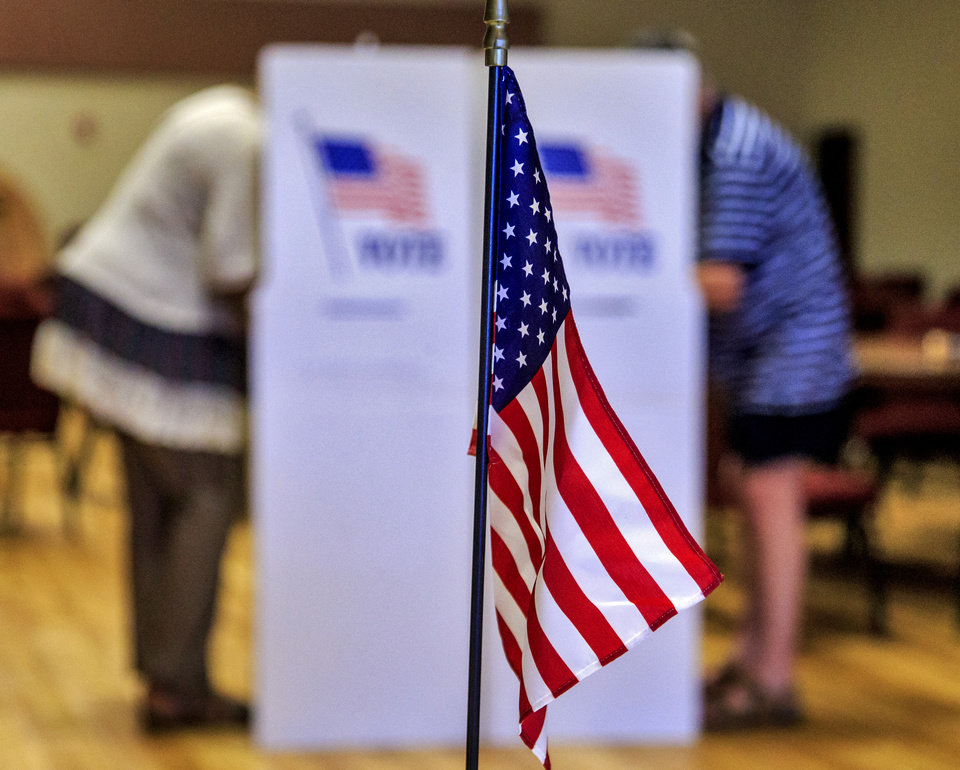 Photo - Voters fill out their ballots on election day at International Pentecostal Assembly in Yukon, Okla. on Tuesday, June 26, 2018.   Photo by Chris Landsberger, The Oklahoman