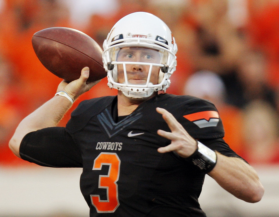Photo - Oklahoma State's Brandon Weeden throws a pass during the first half of the Cowboys 37-14 win on Thursday. PHOTO BY NATE BILLINGS, The Oklahoman