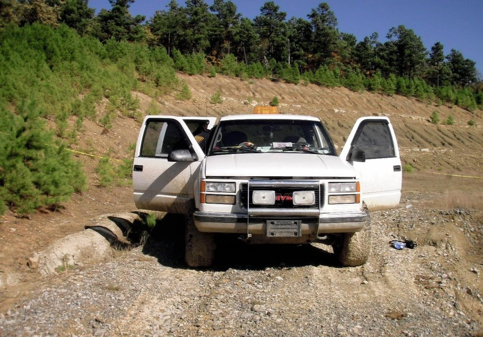 Photo - The Jamison's abandoned pickup, shown above, was found with the doors locked, keys in the ignition and the family dog inside.  PHOTOS Provided by the Latimer County Sheriff's Department