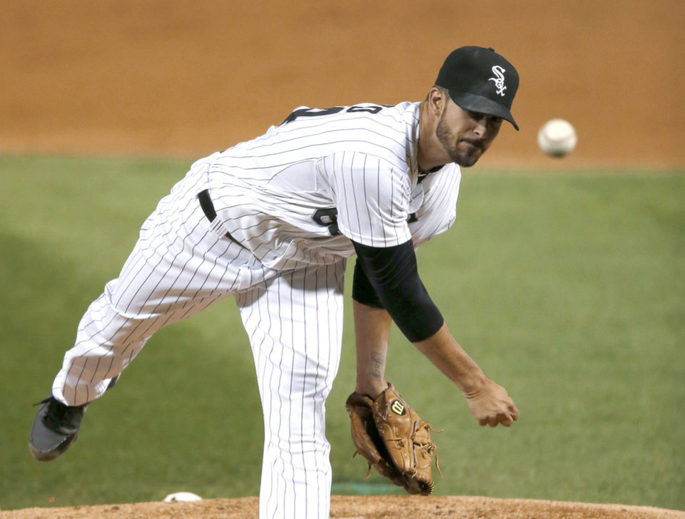 Photo - Chicago White Sox starting pitcher Andre Rienzo delivers during the first inning of a baseball game against the Kansas City Royals on Thursday, Sept. 26, 2013, in Chicago. (AP Photo/Charles Rex Arbogast)