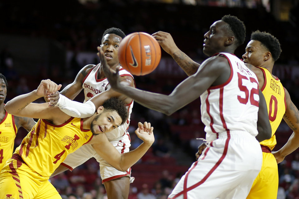 Photo - Oklahoma's Kristian Doolittle (21) and Iowa State's George Conditt IV (4) watch the ball go to past Kur Kuath (52) during an NCAA basketball game between the University of Oklahoma Sooners (OU) and the Iowa State Cyclones at the Lloyd Noble Center in Norman, Okla., Wednesday, Feb. 12, 2020. [Bryan Terry/The Oklahoman]
