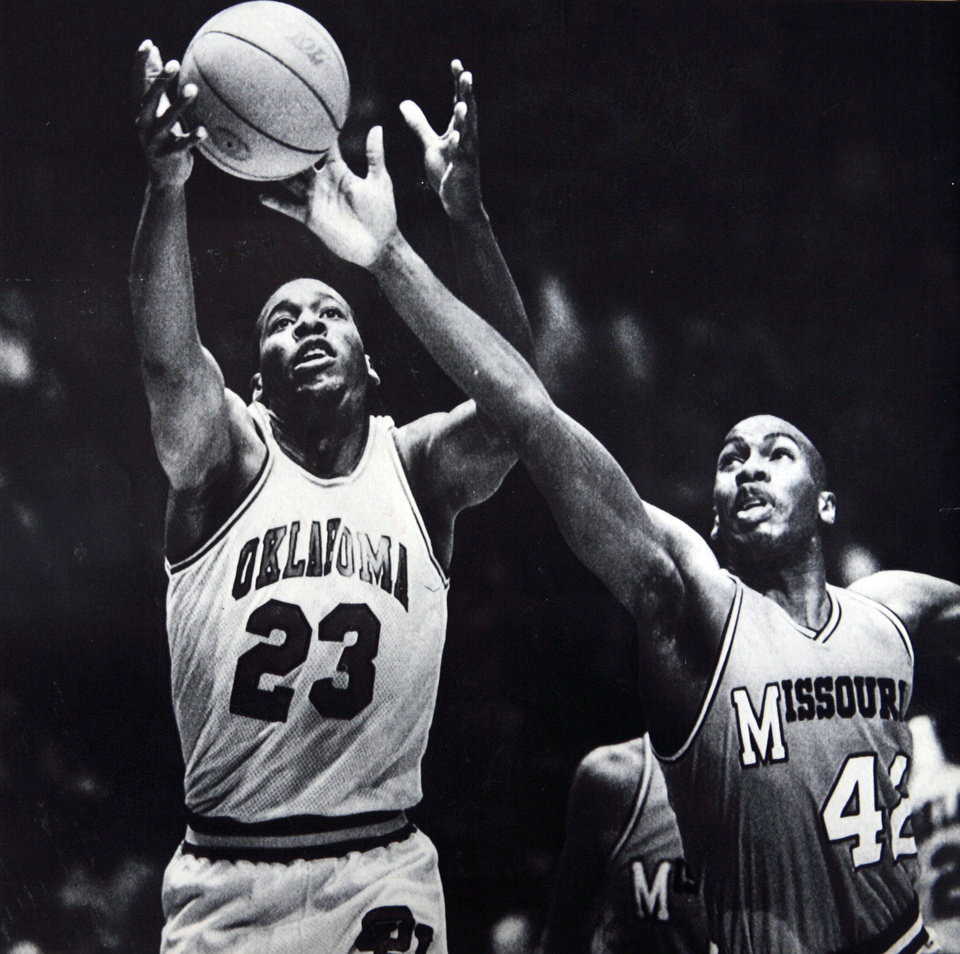 Photo - Former OU basketball player Wayman Tisdale. NORMAN, Okla., Jan. 16--LOOKS TO BLACK THE PASS -- Missouri forward Malcolm Thomas, 42, looks to break up a pass to Oklahoma center Wayman Tisdale, 23, during first half action Wednesday night in Norman,Okla. The 13th ranked Sooners led the Tigers 52-39 at the half. (AP Laserphoto by David Longstreath) 1985. Photo taken 1/16/1985, Photo published 1/17/1985 in The Daily Oklahoman. ORG XMIT: KOD