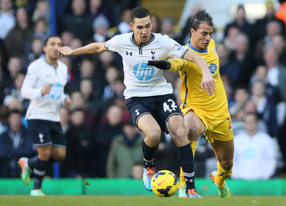 Photo - Tottenham's Nabil Bentaleb, left, goes for the ball with Crystal Palace's Marouane Chamakh during their English Premier League soccer matchat the White Hart Lane stadium in London, Saturday, Jan. 11, 2014. (AP Photo/Alastair Grant)