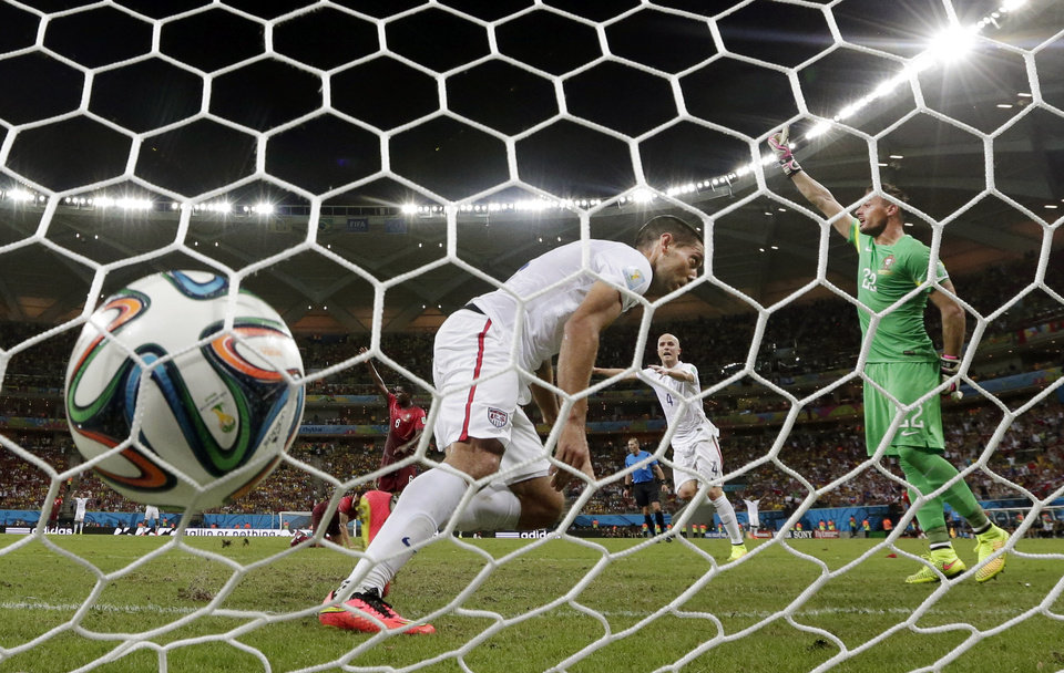 Photo - United States' Clint Dempsey, scores his side's second goal during the group G World Cup soccer match between the USA and Portugal at the Arena da Amazonia in Manaus, Brazil, Sunday, June 22, 2014. (AP Photo/Julio Cortez)