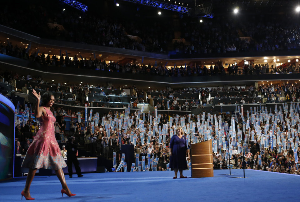 Photo - First Lady Michelle Obama waves to delegates at the Democratic National Convention in Charlotte, N.C., on Monday, Sept. 3, 2012. (AP Photo/Jae C. Hong)  ORG XMIT: DNC806