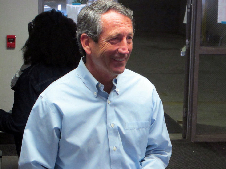 Photo - Former South Carolina Gov. Mark Sanford leaves the voting booth after voting at his precinct in Charleston, S.C., on Tuesday, April 2, 2013. Sanford is facing former Charleston County councilman Curtis Bostic in the Republican runoff for South Carolina's vacant 1st District congressional seat.  (AP Photo/Bruce Smith)