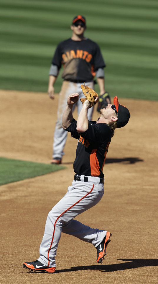 Photo -   San Francisco Giants' Mike Fontenot, right, catches a pop up from Arizona Diamondbacks' Ryan Roberts during the second inning of a spring training baseball game, Sunday, March 4, 2012, in Scottsdale, Ariz. (AP Photo/Darron Cummings)