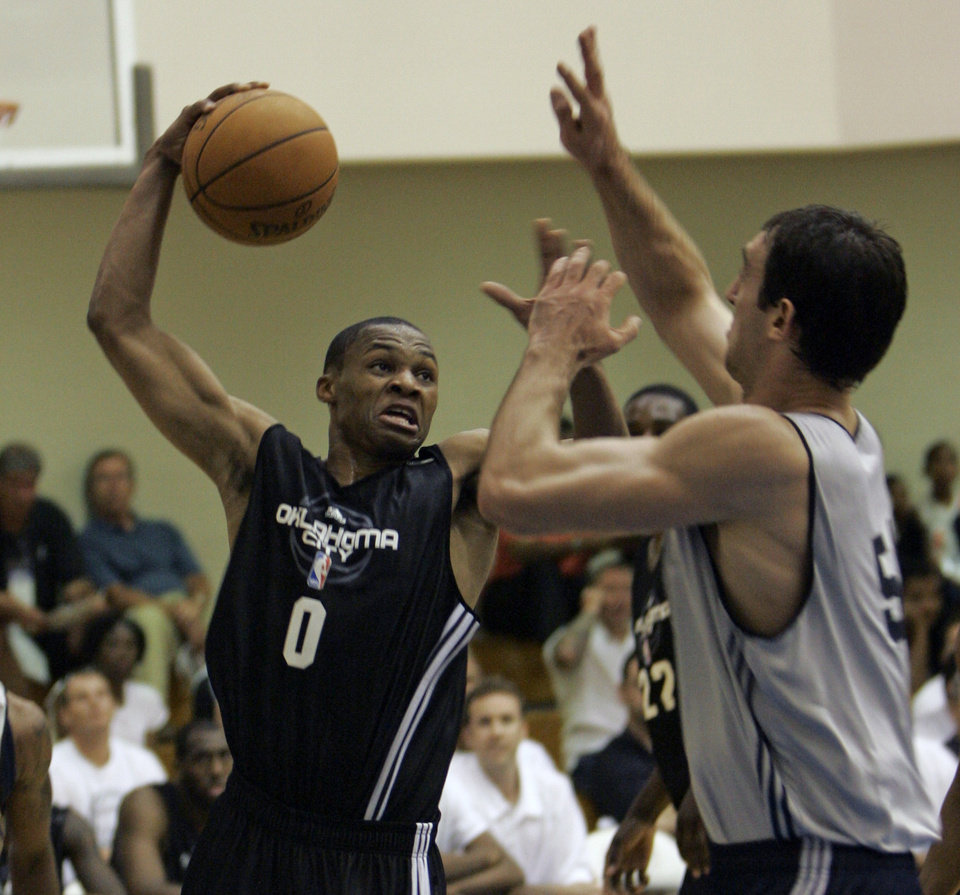 OKC NBA, FORMER SEATTLE SUPERSONICS, SONICS BASKETBALL TEAM: Oklahoma City's guard Russell Westbrook, left  (0), gets off a shot against Indiana Pacers center Vladimir Gulobovic, of Serbia, during an NBA summer league basketball game in Orlando, Fla., Monday, July 7, 2008.(AP Photo/John Raoux) ORG XMIT: FLJR107