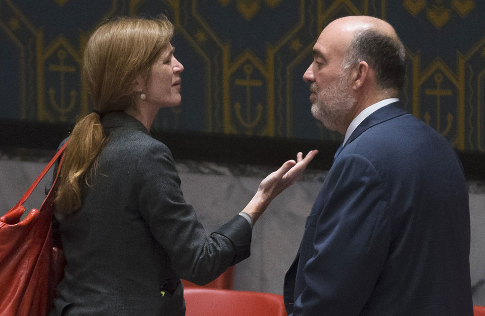 Photo - United States U.N. Ambassador Samantha Power, left, speaks with Israeli U.N. Ambassador Ron Prosor during a meeting of the U.N. Security Council on the situation in Gaza at United Nations headquarters, Monday, July 28, 2014. The U.N. Security Council called for