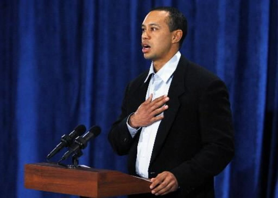 Photo - Tiger Woods addresses the media today. AP Photo