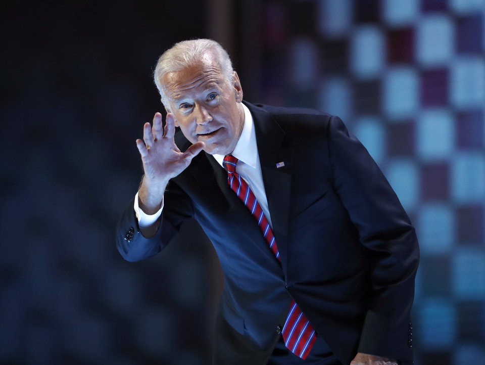 Photo - Vice President Joe Biden waves before speaking during the third day of the Democratic National Convention in Philadelphia , Wednesday, July 27, 2016. (AP Photo/Paul Sancya)