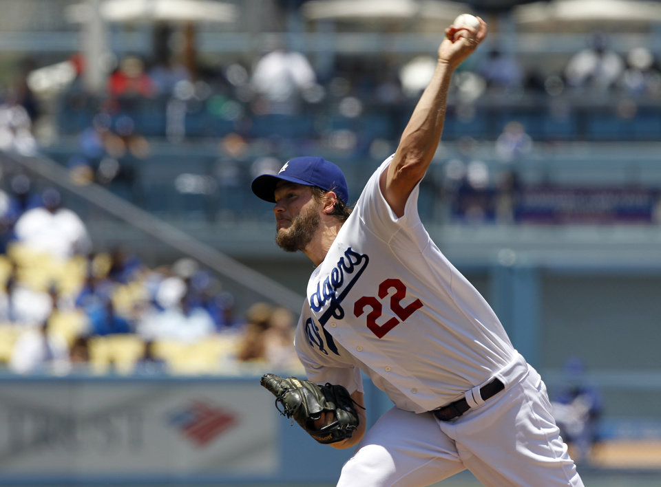 Photo - Los Angeles Dodgers starting pitcher Clayton Kershaw throws against the St. Louis Cardinals in the first inning of a baseball game on Sunday, June 29, 2014, in Los Angeles. (AP Photo/Alex Gallardo)