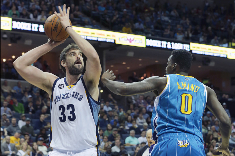 Memphis Grizzlies' Marc Gasol (33), of Spain, shoots over New Orleans Hornets' Al-Farouq Aminu (0) during the first half of an NBA basketball game in Memphis, Tenn., Sunday, Jan. 27, 2013. (AP Photo/Danny Johnston)