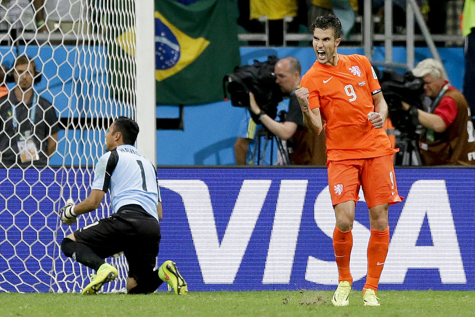 Photo - Netherlands' Robin van Persie celebrates after scoring in a penalty shoot out during the World Cup quarterfinal soccer match between the Netherlands and Costa Rica at the Arena Fonte Nova in Salvador, Brazil, Saturday, July 5, 2014. (AP Photo/Matt Dunham)
