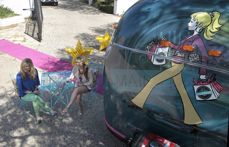 Sande Brandt, left, and Rosie Dalton, sits outside their boutique on wheels, Couture in a Can, March 11, 2013, in Fort Worth, Texas. (Ron T. Ennis/Fort Worth Star-Telegram/MCT)