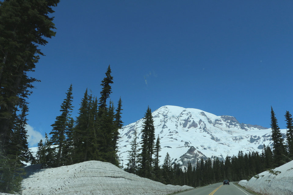 Photo - Mount Rainier is seen from the road to Paradise Visitor Center at Mount Rainier National Park on Sunday, June 1, 2014. Six climbers are presumed dead after officials say they likely fell thousands of feet in the worst alpine accident on the mountain in decades. (AP Photo/Rachel La Corte)