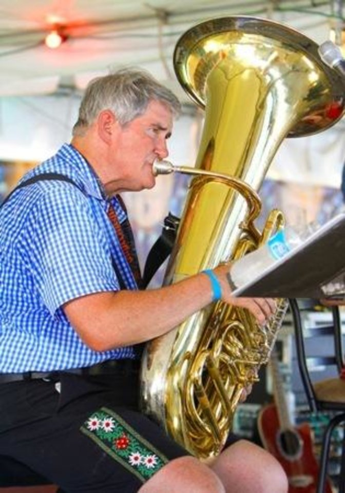 Photo -  Mike Barker with the band Alpenfest plays his tuba during the 2012 Oktoberfest in the Park in Choctaw. Photo By David McDaniel, The Oklahoman Archives