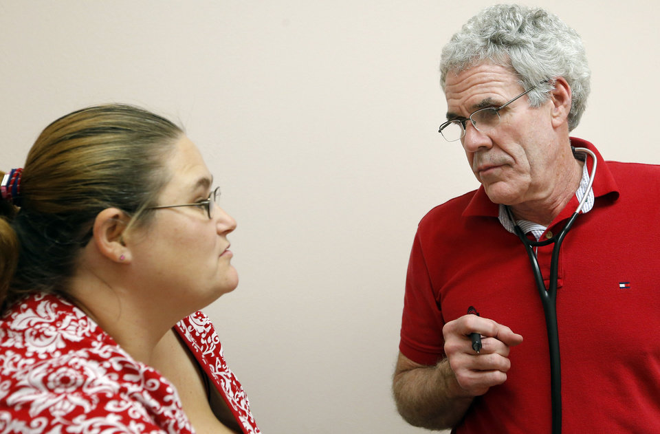 Photo - Rita Nonnen talks to Dr. Fred Loper at  Good Shepherd Ministries' free clinic in Oklahoma City. Photo by Sarah Phipps, The Oklahoman   SARAH PHIPPS - SARAH PHIPPS