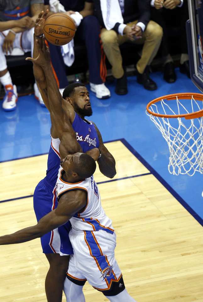 Photo - Oklahoma City's Serge Ibaka (9) defends against Los Angeles' DeAndre Jordan (6) during Game 2 of the Western Conference semifinals in the NBA playoffs between the Oklahoma City Thunder and the Los Angeles Clippers at Chesapeake Energy Arena in Oklahoma City, Wednesday, May 7, 2014. Photo by Sarah Phipps, The Oklahoman