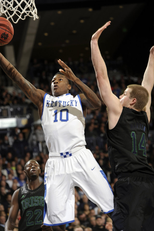 Photo - Kentucky guard Archie Goodwin shoots as Notre Dame forward Scott Martin defends during the first half of an NCAA college basketball game Thursday, Nov. 29, 2012, in South Bend, Ind. (AP Photo/Joe Raymond)