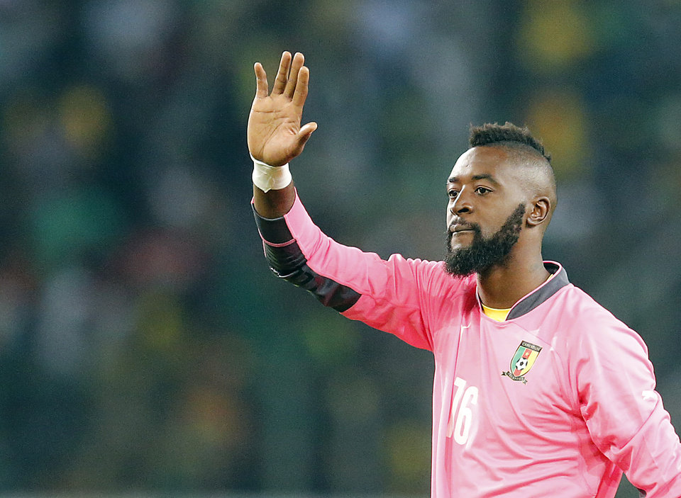 Photo - Cameroon goalkeeper Charles Itandje waves to supporters after a friendly WCup preparation soccer match between Germany and Cameroon in Moenchengladbach, Germany, Sunday, June 1, 2014. The match ends in a 2-2 draw. (AP Photo/Frank Augstein)