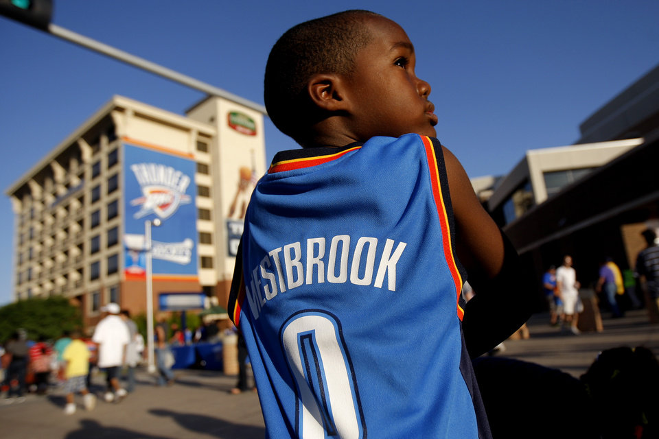 Photo - Jailen Toure, 6, of Oklahoma City walks outside the arena before Game 2 in the second round of the NBA playoffs between the Oklahoma City Thunder and L.A. Lakers at Chesapeake Energy Arena in Oklahoma City, Wednesday, May 16, 2012. Photo by Bryan Terry, The Oklahoman