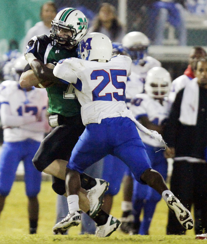 Photo - Jacob Lewis (7) of Bishop McGuinness is stopped by Sheldon Bulock (25) of Millwood after gaining yards during a high school football game between Millwood and Bishop McGuinness at Bishop McGuinness Catholic High School in Oklahoma City, Friday, Sept. 16, 2011. Photo by Nate Billings, The Oklahoman