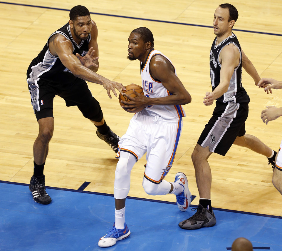 Photo - Oklahoma City's Kevin Durant (35) gets by San Antonio's Tim Duncan (21) and San Antonio's Manu Ginobili (20) during Game 6 of the Western Conference Finals in the NBA playoffs between the Oklahoma City Thunder and the San Antonio Spurs at Chesapeake Energy Arena in Oklahoma City, Saturday, May 31, 2014. Photo by Nate Billings, The Oklahoman