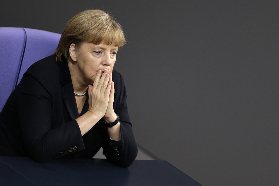 Photo - German Chancellor Angela Merkel attends a meeting of the German federal parliament, Bundestag, in Berlin, Germany, Thursday, Nov. 29, 2012. (AP Photo/Michael Sohn)