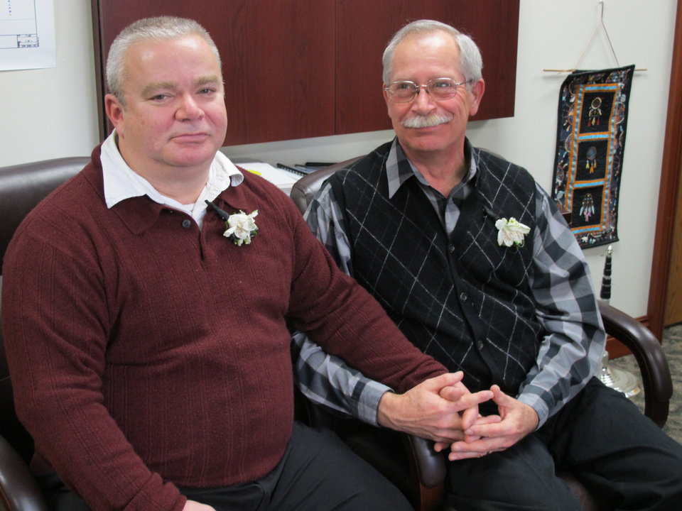 Tim LaCroix, left, and Gene Barfield relax in the tribal chairman�s office, Friday, March 15, 2013, in Harbor Springs, Mich., after becoming the first gay couple wed under a newly approved measure allowing same-sex marriage for members of the Little Traverse Bay Bands of Odawa Indians in Michigan. (AP Photo/John Flesher)