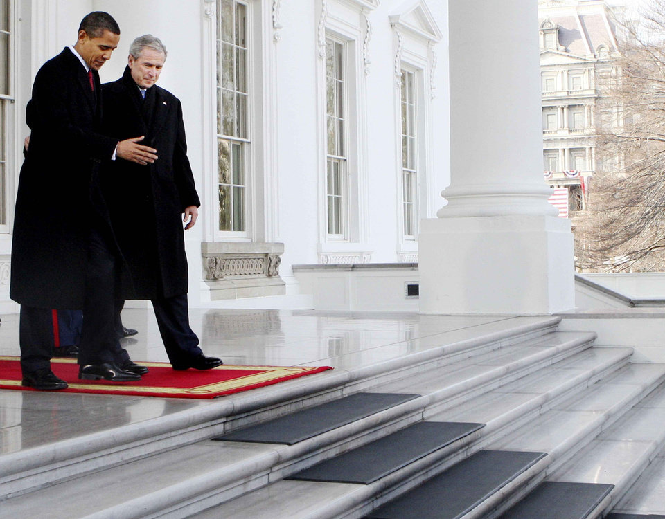 Photo - President Bush, right, walks out with President-elect Barack Obama, on the North Portico of the White House before sharing the presidential limousine enroute to Capitol Hill for inauguration in Washington, Tuesday, Jan. 20, 2009. (AP Photo/Pablo Martinez Monsivais)