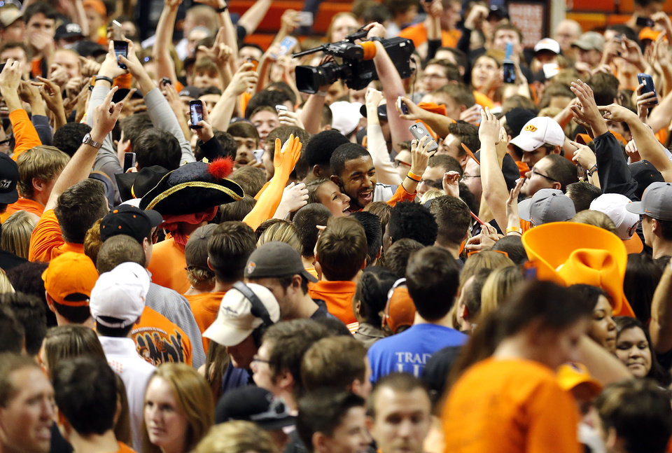 Photo - Oklahoma State's Michael Cobbins (20) takes a selfie with a fan following the men's college basketball game between Oklahoma State University and the University of Kansas at Gallagher-Iba Arena in Stillwater, Okla.,  Saturday, Feb. 7, 2015. OSU won 67-62. Photo by Sarah Phipps, The Oklahoman