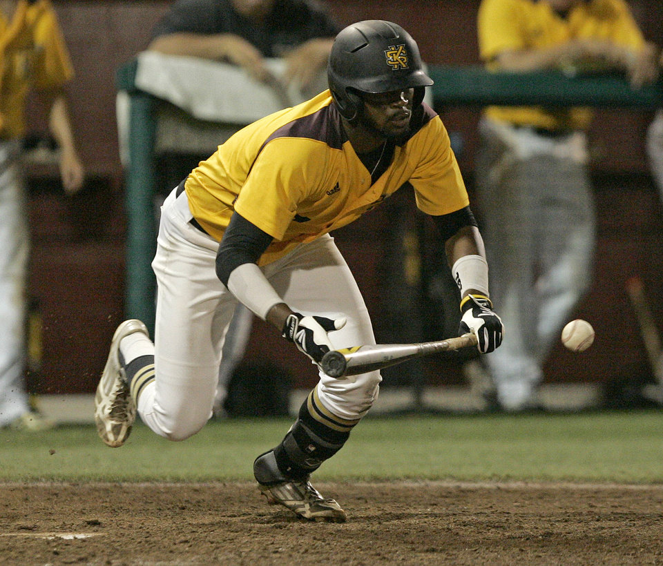 Photo - Kennesaw State's Justin Motley lays down a bunt against Georgia Southern in the eleventh inning of an NCAA regional college baseball game on Saturday,  May 31, 2014, in Tallahassee, Fla. Kennesaw State won the game 13-5.  (AP Photo/Steve Cannon)