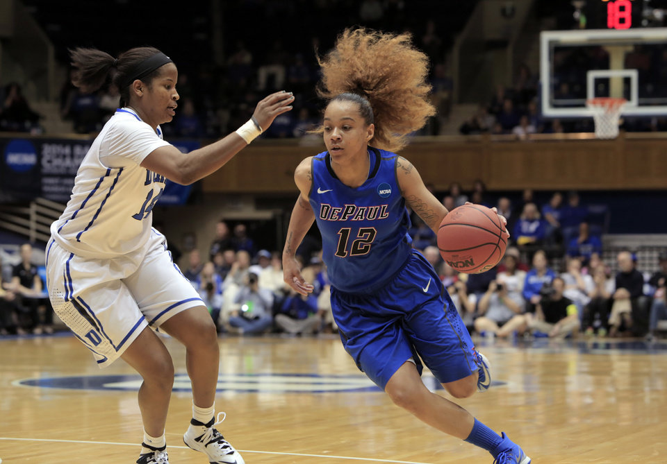 Photo - DePaul's Brittany Hrynko (12) dribbles past Duke's Ka'Lia Johnson during the second half of Duke's 74-65 loss in their second-round game in the NCAA basketball tournament in Durham, N.C., Monday, March 24, 2014.  (AP Photo/Ted Richardson)
