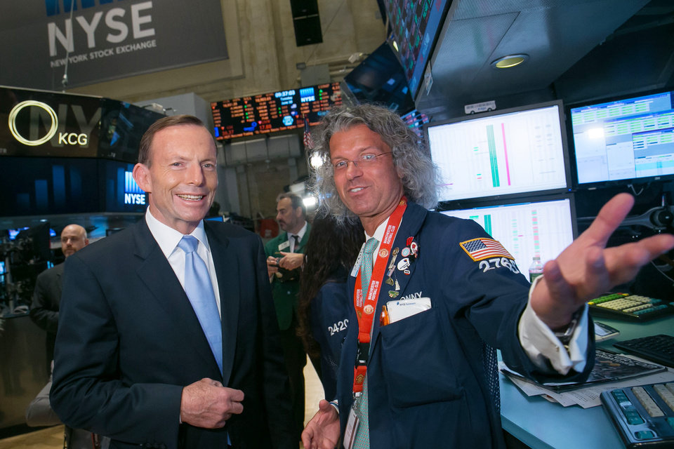 Photo - In this photo provided by NYSE Euronext, Australian Prime Minister Tony Abbott, left, visits a trading post at the New York Stock Exchange in New York, Tuesday, June 10, 2014. (AP Photo/NYSE Euronext, Ben Hider)