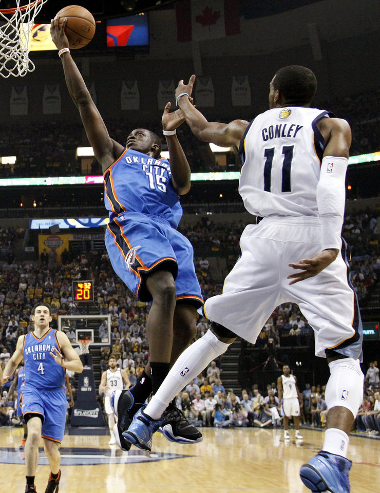 Oklahoma City's Reggie Jackson (15) moves to the hoop against Memphis' Mike Conley (11) during Game 3 in the second round of the NBA basketball playoffs between the Oklahoma City Thunder and Memphis Grizzles at the FedExForum in Memphis, Tenn.,  Saturday, May 11, 2013. Photo by Nate Billings, The Oklahoman